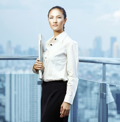 Asian businesswoman office worker in downtown business district.