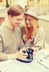 smiling couple with photo camera