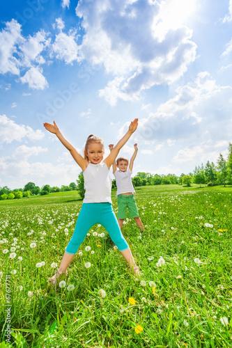 Two children doing gymnastics