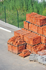 Stack of orange clay brick on construction site