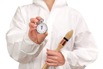 female painter holding a stopwatch