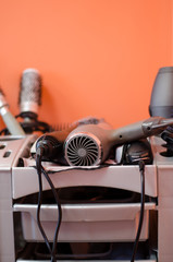 hairdressing accessories  lies in the gray shelf