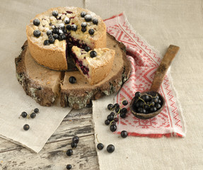 Blackcurrant crumble on wooden stump