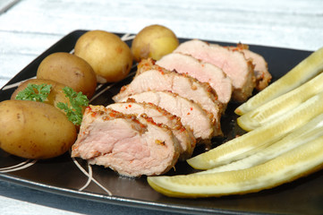 pork meat potatoes and cucumbers
