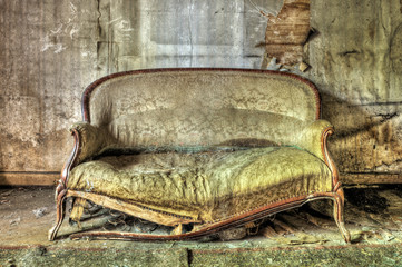 Rotten sofa in an abandoned house