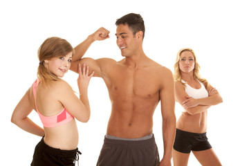fitness man with two women one touch muscle