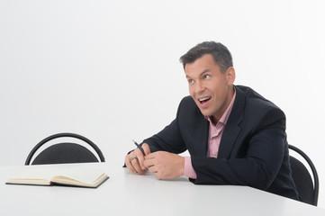 Mature manager at desk