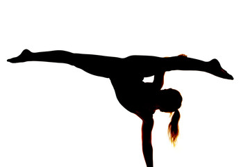 silhouette of woman dancing on one hand legs out