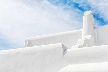 Stylish white chimney against sky in Mykonos