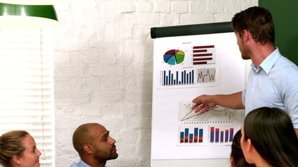 Businessman presenting data to colleagues