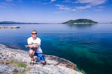 Angler with sea trout in Norway