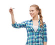 smiling young woman writing on virtual screen