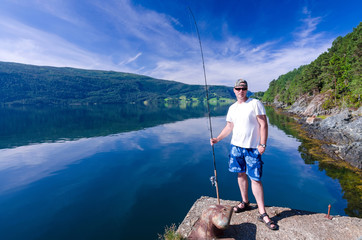Angler and Norwegian fjord