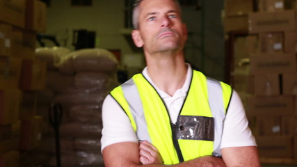 Warehouse worker walking towards camera and smiling