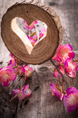 Light  heart on rustic wooden background