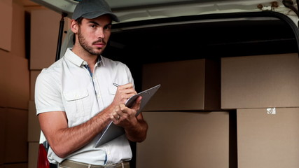 Delivery driver checking his list