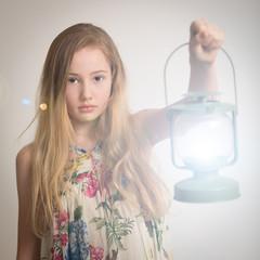 Blond Girl Holding a Lantern.