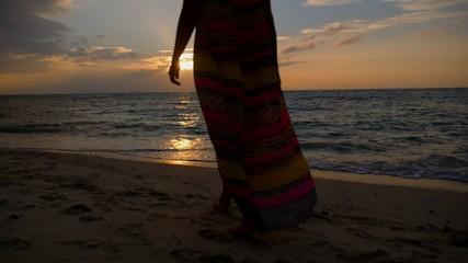 Woman Walking on Empty Beach towards Sunset. Slow Motion.
