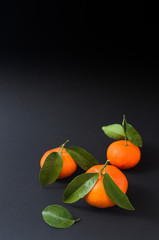 Mandarin with green leaf