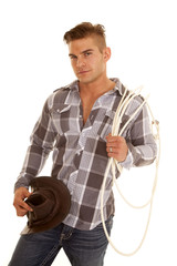 man plaid shir rope western hat look smile