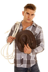 man plaid shirt rope western hat looking
