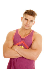 man purple tank top arms folded close slight smile