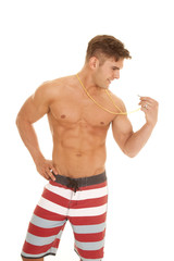 man red white stripe shorts hold whistle side