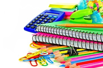 Group of colorful school supplies over white