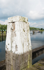 Old and weathered bollard from close