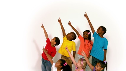 Cute little children all pointing up on white background