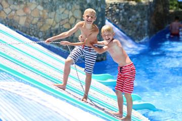 Two happy boys having fun in aqua park