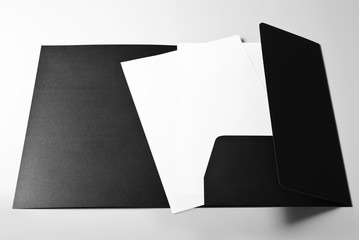 Folder and blank sheets of paper