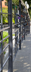 Symbolic padlocks on the city handrail
