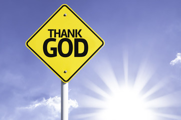 Thank God road sign with sun background