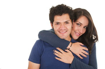 hispanic young couple hugging