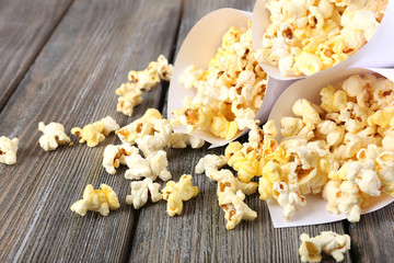 Popcorn on wooden table, close up