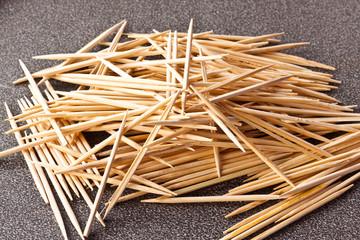toothpicks on wood background