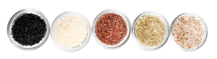 Different sea salt in bowls isolated on white