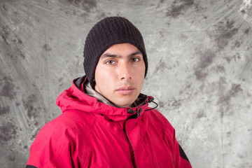 closeup of young handsome man wearing red jacket and black