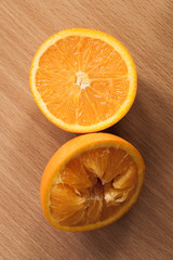 Fresh oranges on wooden table.
