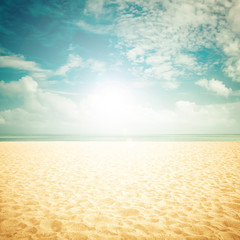 Sunshine on empty beach - vintage look