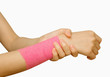 Sports injury ,young woman with pink banage having pain in her w