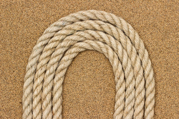 Jute rope on the sea sand. Background
