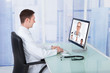 Doctor Video Conferencing With Colleagues Through Computer