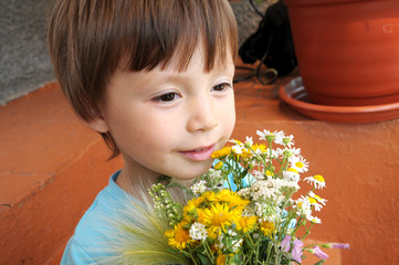 Boy with the bouquet of wildflowers