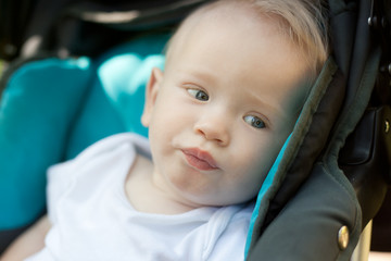 year-old child in a stroller, in soft focus