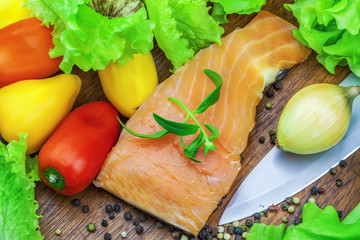 Salmon with various vegetables around