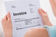 Woman Holding Invoice