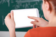Woman Using Digital Tablet In Classroom