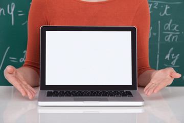 Student Displaying Laptop With Blank Screen In Classroom